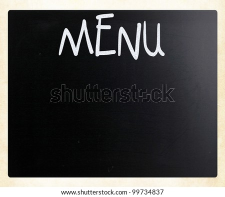"The word ""Menu"" handwritten with white chalk on a blackboard - stock photo"