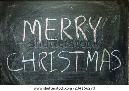 "The word ""MERRY CHRISTMAS"" written on blackboard  - stock photo"