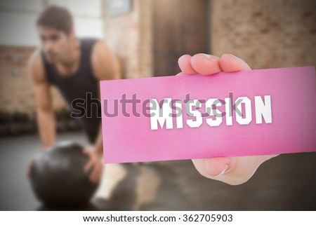The word mission and young woman holding blank card against - stock photo