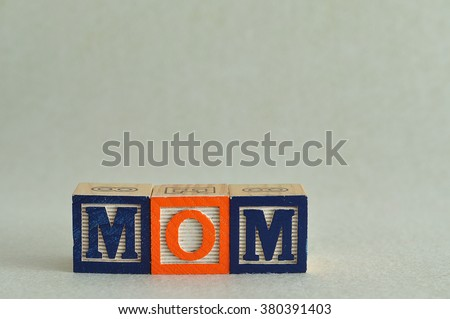 The word mom spelled with colorful alphabet blocks isolated against a white background - stock photo