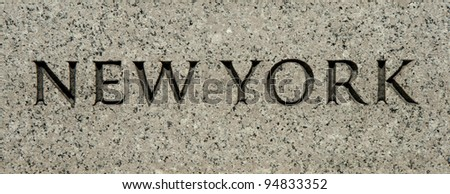 "The word ""New York"" carved into granite - stock photo"