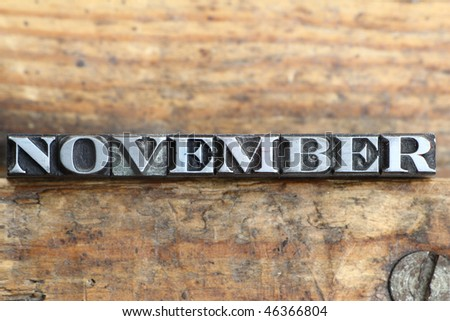 the word november in letterpress type on a wooden background. - stock photo