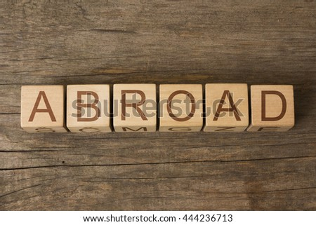 the word of ABROAD on wooden cubes - stock photo
