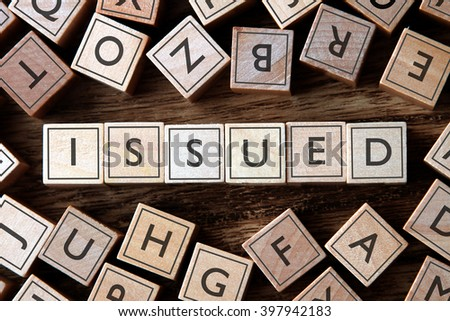 the word of ISSUED on building blocks concept - stock photo