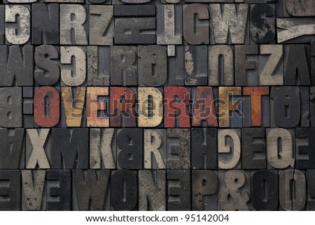 The word Overdraft written in antique letterpress printing blocks. - stock photo