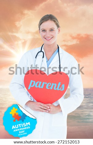 The word parents and doctor holding red heart card against sunrise over magical sea - stock photo