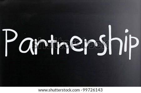 "The word ""Partnership"" handwritten with white chalk on a blackboard - stock photo"