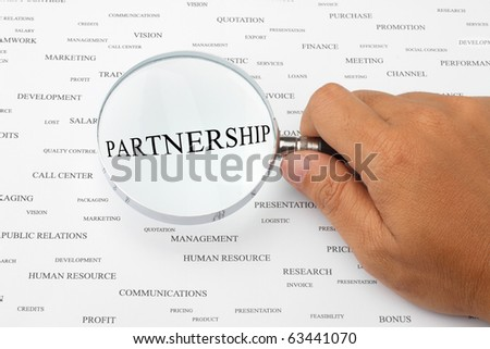 The word PARTNERSHIP is magnified. - stock photo