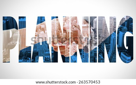 The word planning and closeup of shaking hands after business meeting against high angle view of city - stock photo