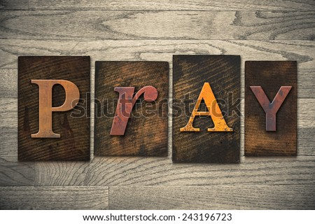 "The word ""PRAY"" written in wooden letterpress type. - stock photo"