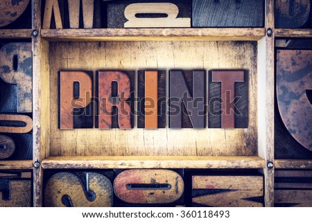 "The word ""Print"" written in vintage wooden letterpress type. - stock photo"