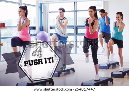 The word push it! and instructor with fitness class performing step aerobics exercise against hexagon - stock photo