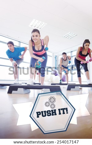 The word push it! and instructor with fitness class performing step aerobics exercise with dumbbells against hexagon - stock photo