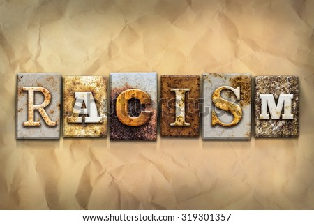 "The word ""RACISM"" written in rusty metal letterpress type on a crumbled aged paper background. - stock photo"