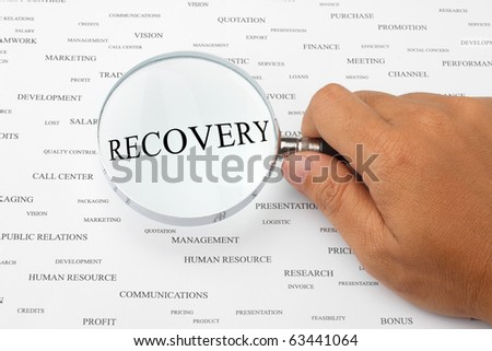 The word RECOVERY is magnified. - stock photo