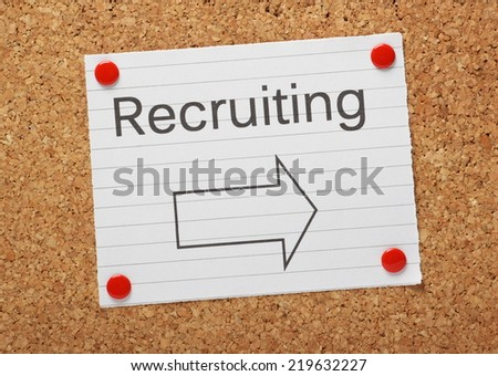 The word Recruiting typed above an arrow pointing in the right direction on a piece of note paper pinned to a cork notice board - stock photo