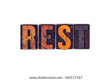 """The word """"Rest"""" written in isolated vintage wooden letterpress type on a white background. - stock photo"""