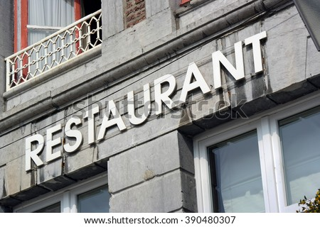 The word Restaurant at facade of old building in Wallonia, Belgium - stock photo