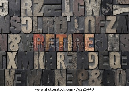 The word Retire written in antique letterpress printing blocks. - stock photo