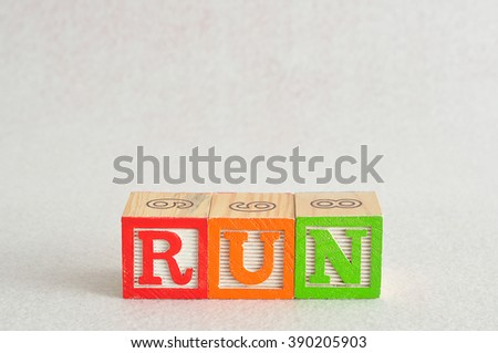 The word run spelled with colorful alphabet blocks isolated against a white background - stock photo