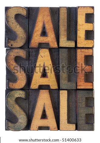the word sale (three versions) in vintage wooden letterpress type, stained by ink, isolated on white - stock photo