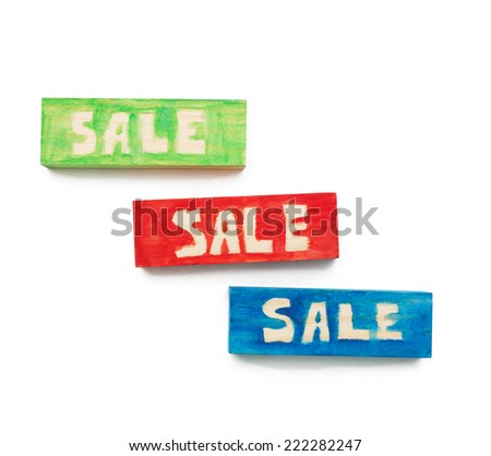 the word 'sale' using colorful cubes, isolated on white - stock photo