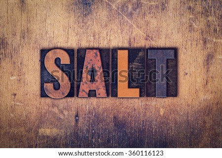 """The word """"Salt"""" written in dirty vintage letterpress type on a aged wooden background. - stock photo"""