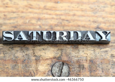 the word saturday in letterpress type on a wooden background. - stock photo