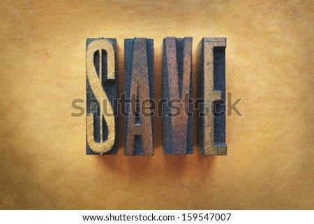 The word SAVE written in vintage letterpress type. - stock photo