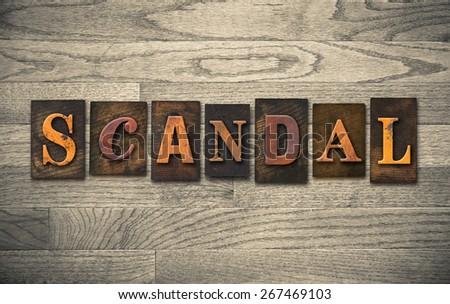 """The word """"SCANDAL"""" theme written in vintage, ink stained, wooden letterpress type on a wood grained background. - stock photo"""