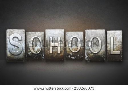 The word SCHOOL written in vintage letterpress type - stock photo