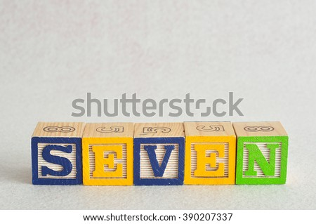 The word seven (7) spelled with colorful alphabet blocks isolated against a white background - stock photo