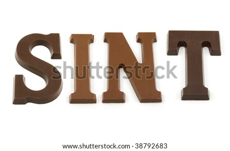 "The word ""Sint"" in chocolate letters isolated on white background, typical Dutch candy for Sinterklaas event in december - stock photo"