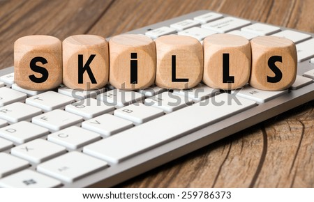 the word skills in wooden block dice concept - stock photo