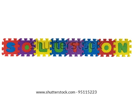 """The word """"Solution"""" written with alphabet puzzle letters isolated on white background - stock photo"""