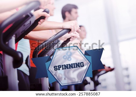 The word spinning and fit people working out at spinning class against hexagon - stock photo