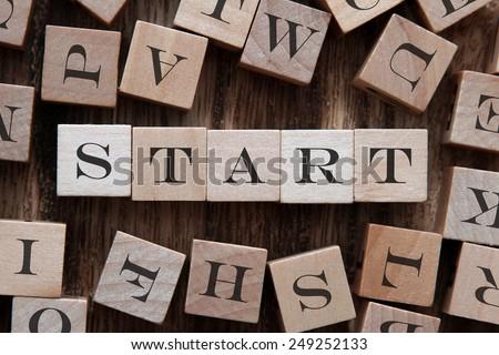 the word start on wood blocks - stock photo