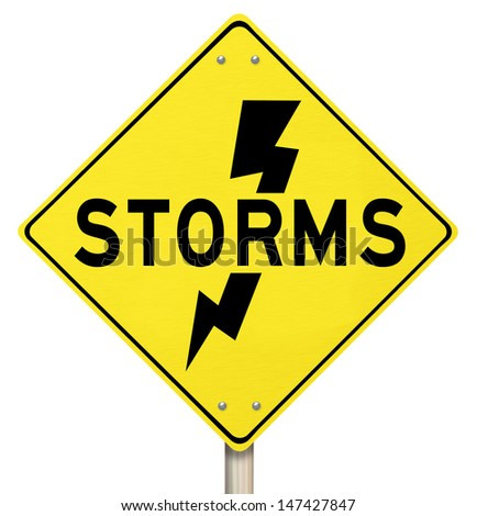 The word Storms on a yellow warning sign and a bolt of lightning icon to  illustrate dangerous thunderstorms - stock photo
