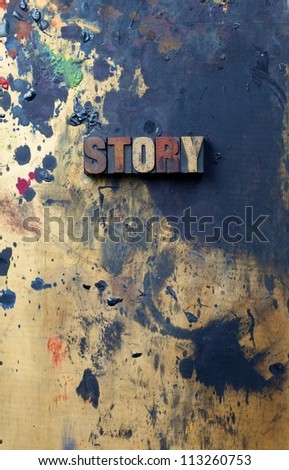 The word Story written in antique letterpress printing blocks. - stock photo