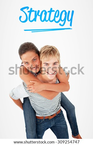 The word strategy and young boy giving his friend piggyback ride against white background with vignette - stock photo