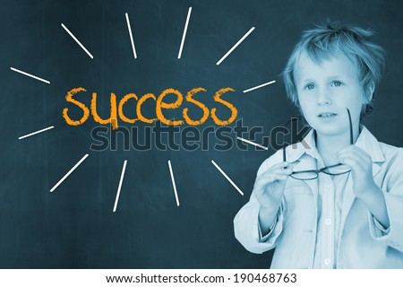 The word success against schoolboy and blackboard - stock photo