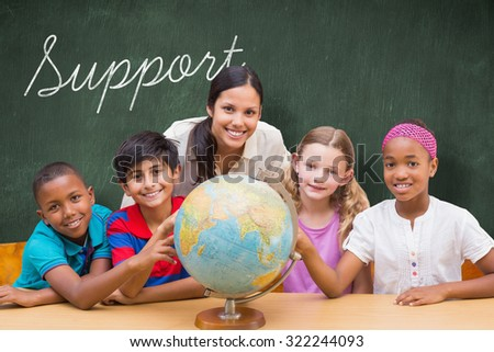 The word support and cute pupils and teacher looking at globe in library against green chalkboard - stock photo