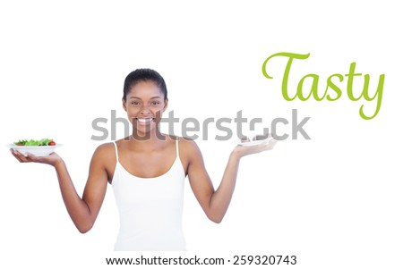 The word tasty against happy woman deciding to eat healthily or not - stock photo