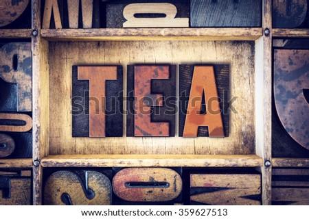 "The word ""Tea"" written in vintage wooden letterpress type. - stock photo"