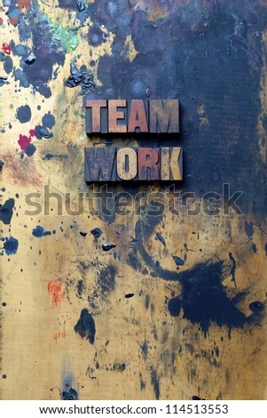 The word Team Work written in very old and well used letterpress type. - stock photo