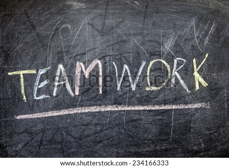 "The word ""TEAM WORK"" written on blackboard  - stock photo"
