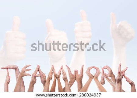 the word teamwork in front of hands holding thumbs up - stock photo