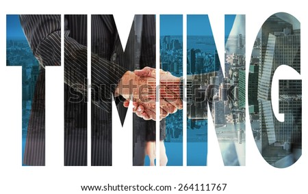 The word timing and business people shaking hands - stock photo