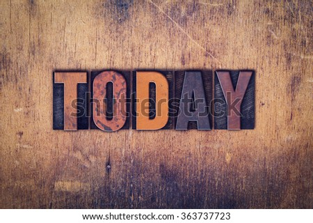 """The word """"Today"""" written in dirty vintage letterpress type on a aged wooden background. - stock photo"""