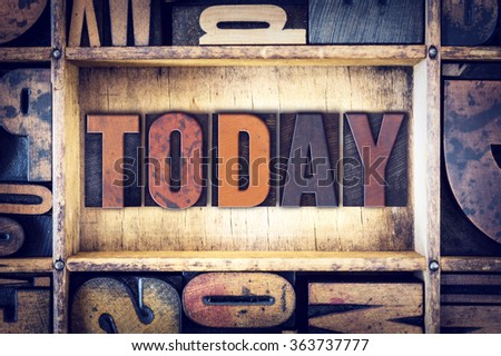 """The word """"Today"""" written in vintage wooden letterpress type. - stock photo"""